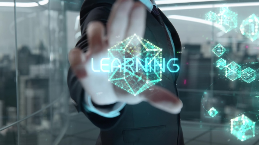 Businessman with Learning hologram concept   Shutterstock HD Video #1041459850