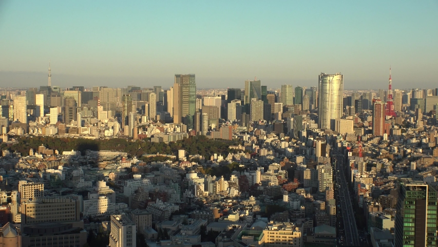 TOKYO, JAPAN - NOVEMBER 2019 : Aerial high angle view of cityscape of TOKYO in sunset. Scenery of central downtown area and business district. Clear blue and purple skyline. Pan down from sky. | Shutterstock HD Video #1041461200