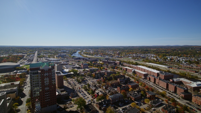 Manchester New Hampshire Aerial v1 Slow panoramic to birdseye to reverse downtown cityscape - October 2017