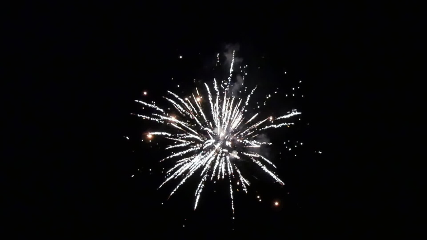 Burst of bright colorful part fireworks on black background to create a set salute on video for holiday new year, birthday, wedding or other celebration. | Shutterstock HD Video #1041517780