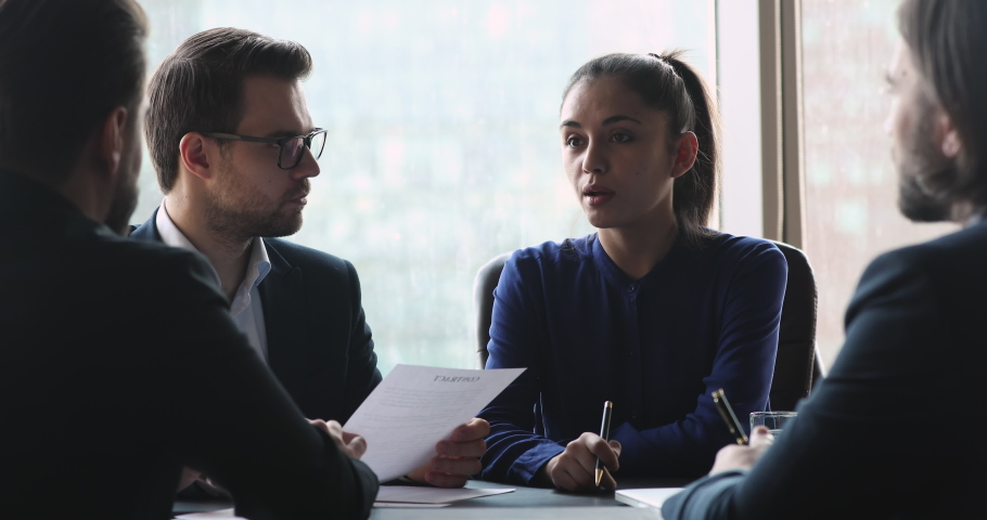 Confident female leader negotiating with business group explaining contract benefits at formal board meeting consulting corporate clients presenting commercial offer sit at conference office table | Shutterstock HD Video #1041547660