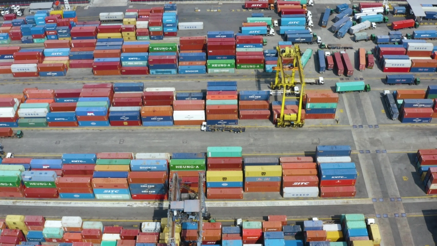 JAKARTA, Indonesia - November 19, 2019: Aerial view of containers and trucks in Tanjung Priok industrial port | Shutterstock HD Video #1041548380