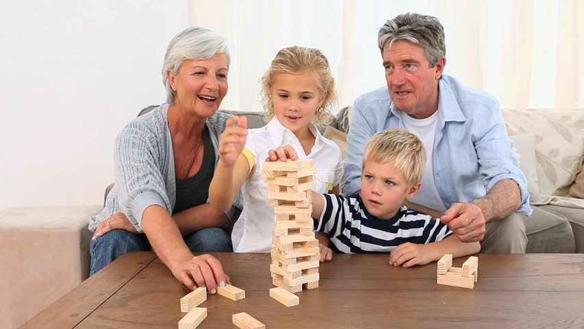 Family Playing A Building Game In The Living Room
