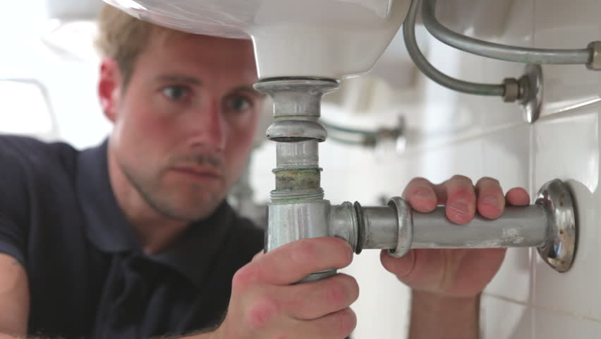Plumber inspects joints underneath sink. Shot on Canon 5D Mk2 at at a frame rate of 25 fps