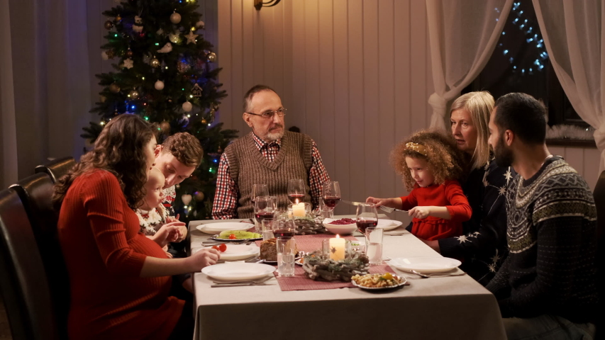 New Year. Served Holiday Table. Woman Serves Chicken Main Dish. At The Table, All Generations Of Grandparents, Children And Grandchildren. #1041733210