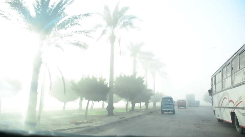 Fasr driving in early morning after sunshine in Cairo Alexandria motor way in Egypt in November 2019ect Object] | Shutterstock HD Video #1041989650