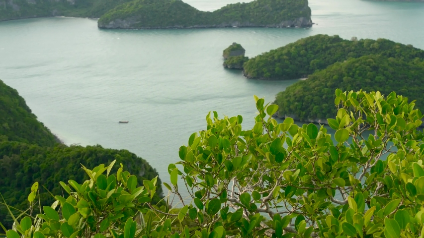 Bird eye panoramic aerial top view of Islands in ocean at Ang Thong National Marine Park near touristic Samui paradise tropical resort. Archipelago in the Gulf of Thailand. Idyllic natural background. | Shutterstock HD Video #1042276990