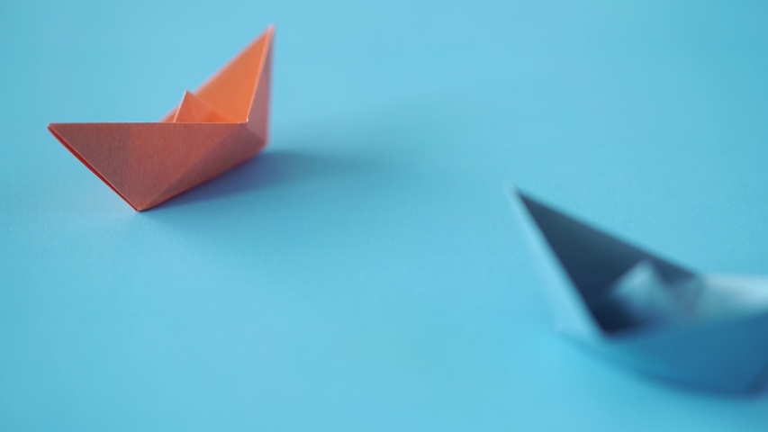 Paper boat on clean blue background with copy space, lesson and education concept   Shutterstock HD Video #1042365730