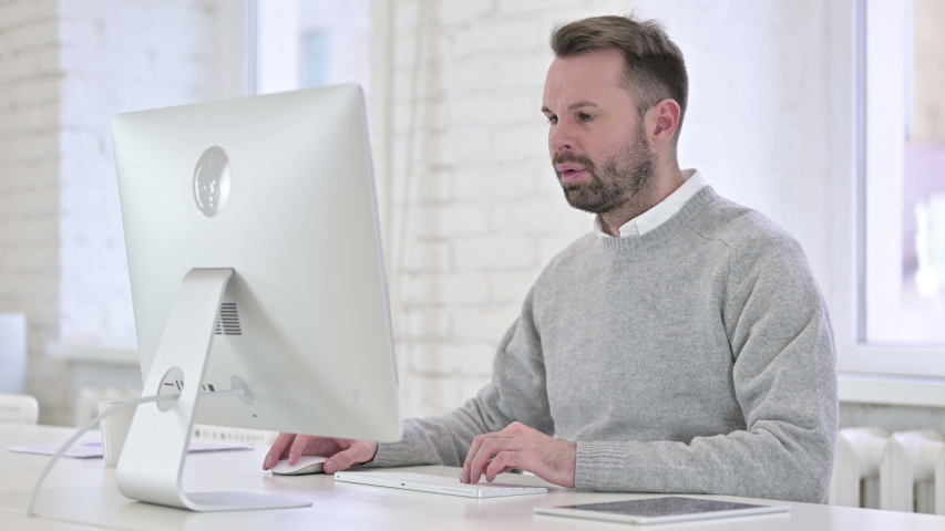 Tired Creative Man Sleeping while Working on Computer | Shutterstock HD Video #1042419370