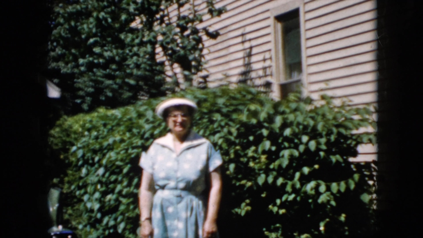 CALIFORNIA USA-1969: Vintage Home Video Of Lady Standing In Yard Waving At The Camera