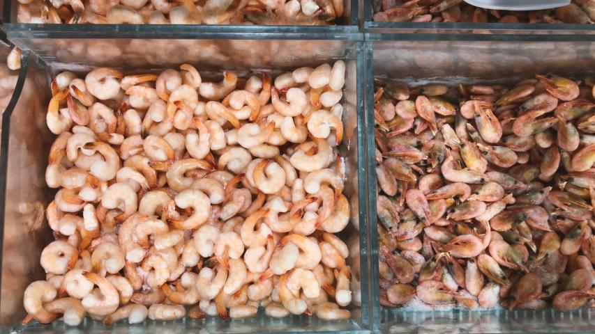 Assortment frozen shrimps in fridge at supermarket, top view | Shutterstock HD Video #1042541500