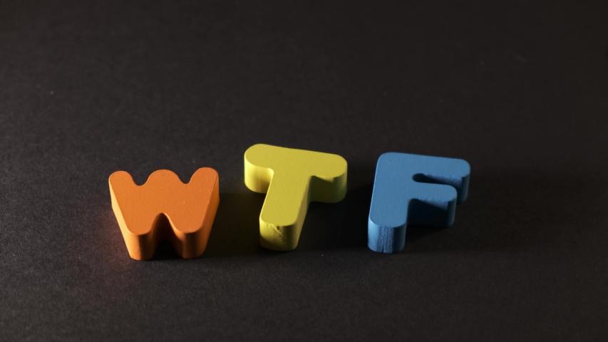 """wtf"" lettering in multicolored letters on a black background. Creative idea | Shutterstock HD Video #1042561660"