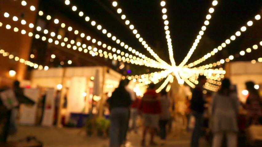 Blurred Light Bokeh at Night Market Timelapse people walking happy holiday | Shutterstock HD Video #1042747840