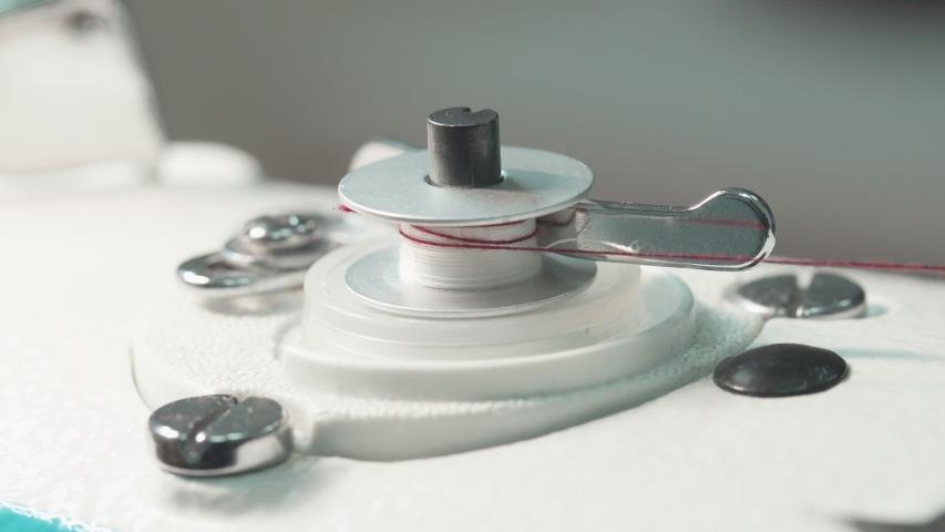Video of spinning bobbin of thread | Shutterstock HD Video #1042795240