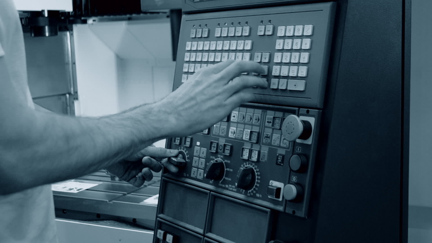 Person works behind the control panel of the production machine at the factory.Industrial machinery, production aggregation and equipment mechanical automaton. Heavy machinery   Shutterstock HD Video #1042859170