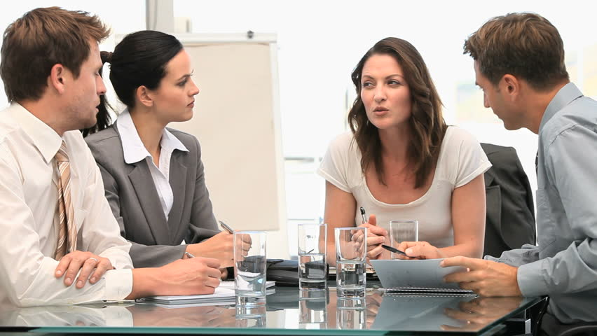 Female manager speaking with her team | Shutterstock HD Video #1042867
