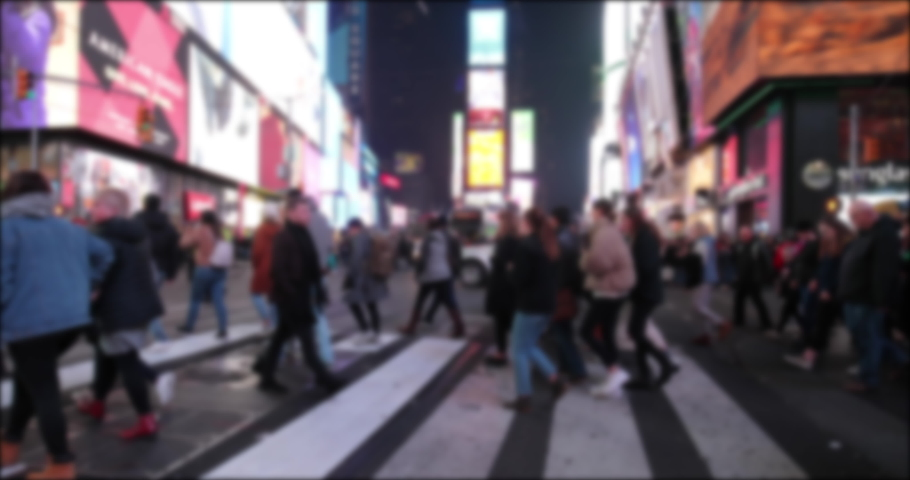Crowd of people walking crossing street in New York Times Square at night   Shutterstock HD Video #1043640460