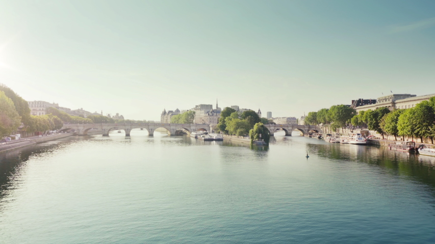 View from the Pont des Arts on old bridge across the Seine river in Paris | Shutterstock HD Video #1044513160