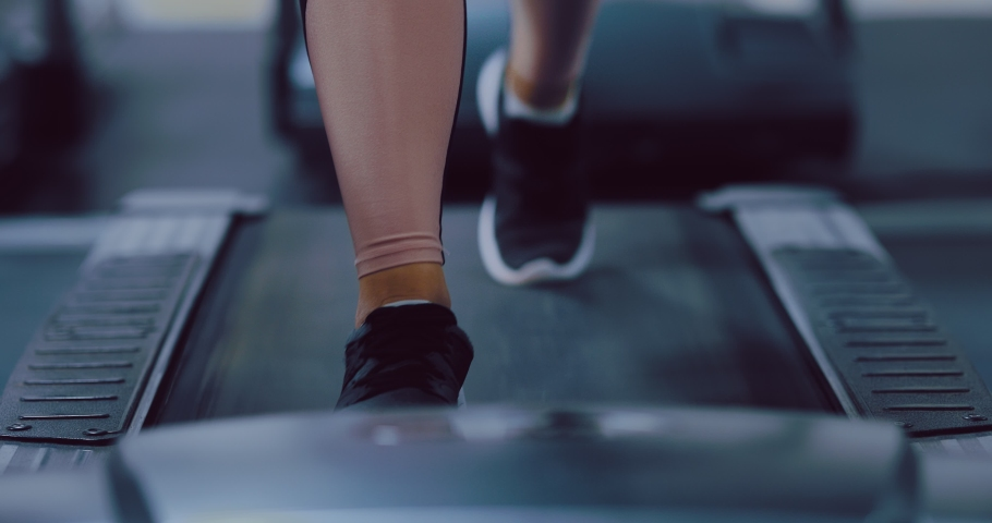 Female legs are walking on a treadmill, leg exercises. Running simulator in the gym. Close-up. | Shutterstock HD Video #1044742960
