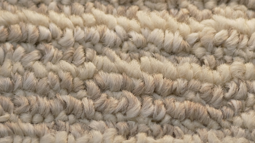 Macro closeup soft beige carpet rug texture | Shutterstock HD Video #1044743770