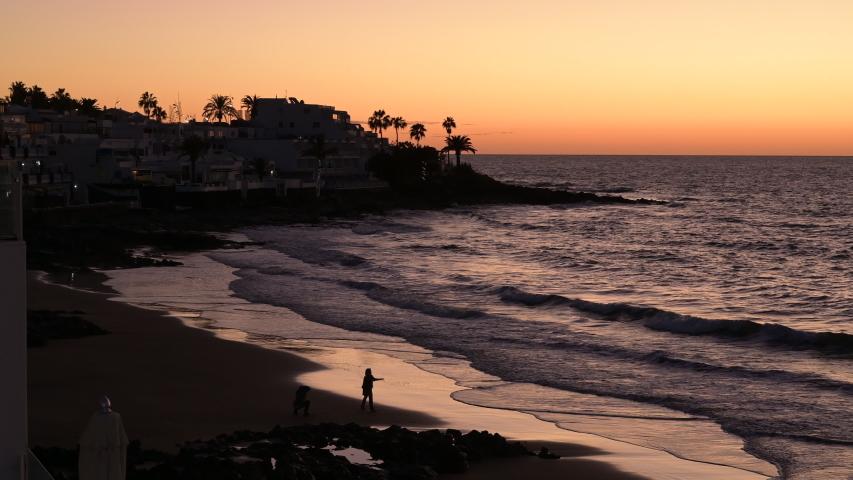 Sunrise over a holiday beach | Shutterstock HD Video #1045033600
