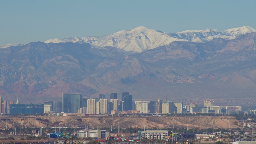 Morning view of the famous Las Vegas Strip skyline with mountain behind at Nevada | Shutterstock HD Video #1045069480