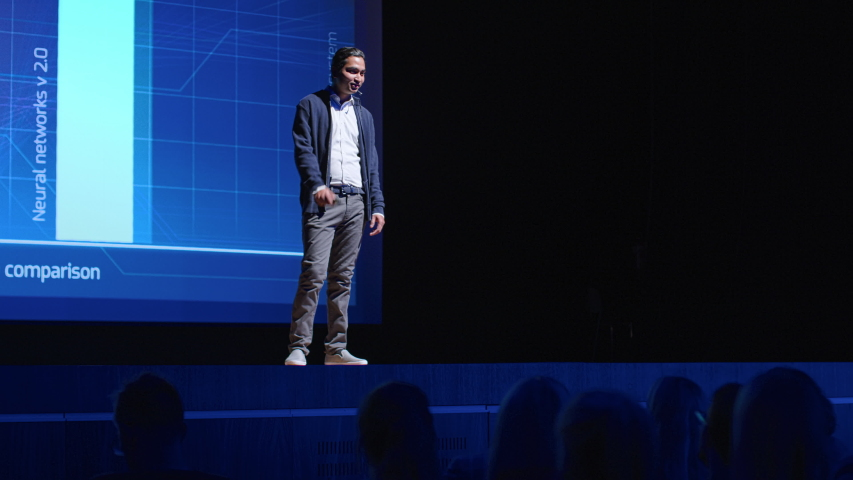 Business Conference Stage: Indian Tech Startup CEO Presents Firm's Newest Product, He's Holding Laptop and Does Motivational Talk about Science, Technology, Entrepreneurship, Software Development | Shutterstock HD Video #1045102510