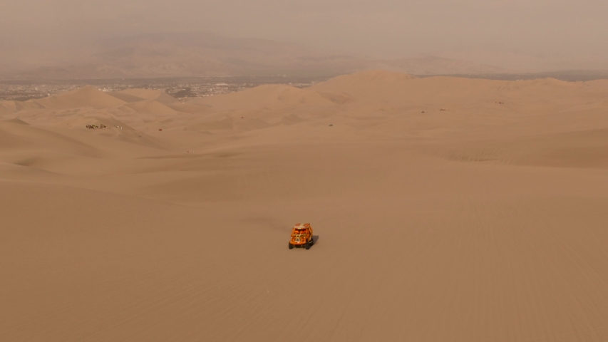 Sandy desert oasis lake. DRONE. Water in middle of hot sand desert. Romantic, holiday, honeymoon, scenic shot, Adventure Dune Buggy. Speed. Tourism shot in Huacachina, Peru. Epic, Fast. | Shutterstock HD Video #1045192930