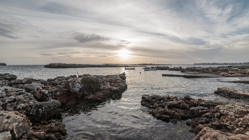 Stunning Sunset View Of The Binisafua Port In South Menorca With Calm, Peaceful Waters - Time Lapse | Shutterstock HD Video #1045450780