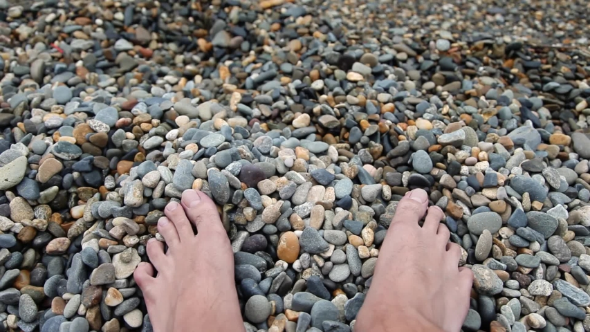 Closeup of feet on the pebbled beach by the sea outdoors | Shutterstock HD Video #1045456030