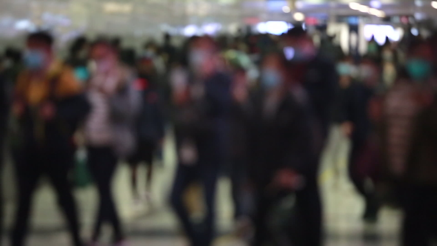 Blurred masked people with motion in Hong Kong  | Shutterstock HD Video #1045863010