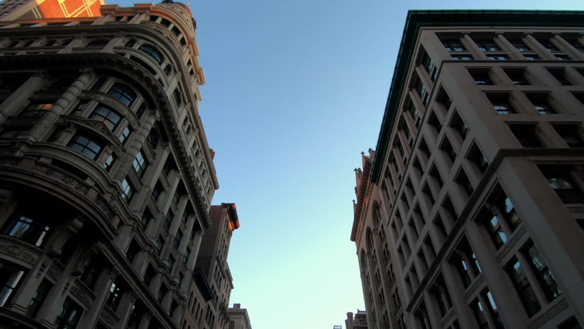 POV view. Driving between old buildings in New York City on a sunny day | Shutterstock HD Video #1046597470