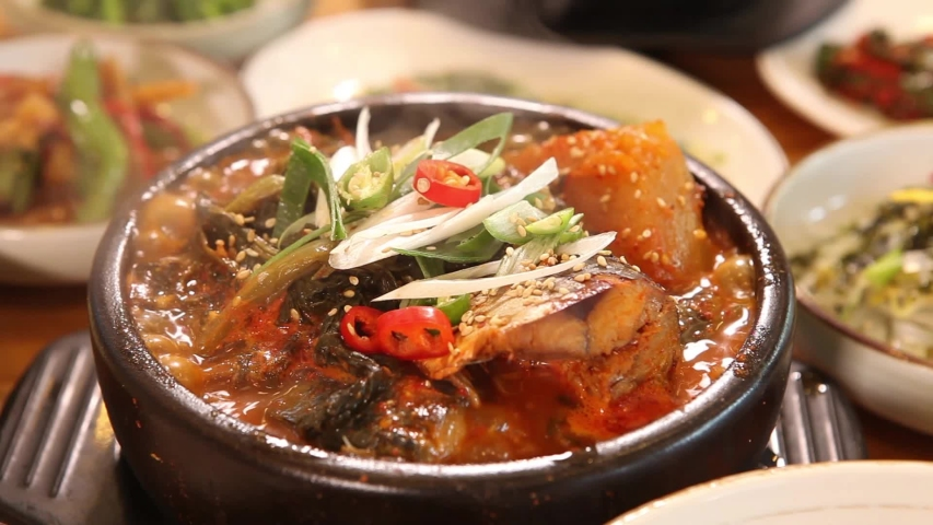 Dongtaetang, a Korean dish cooked with various vegetables and fish   Shutterstock HD Video #1046775910