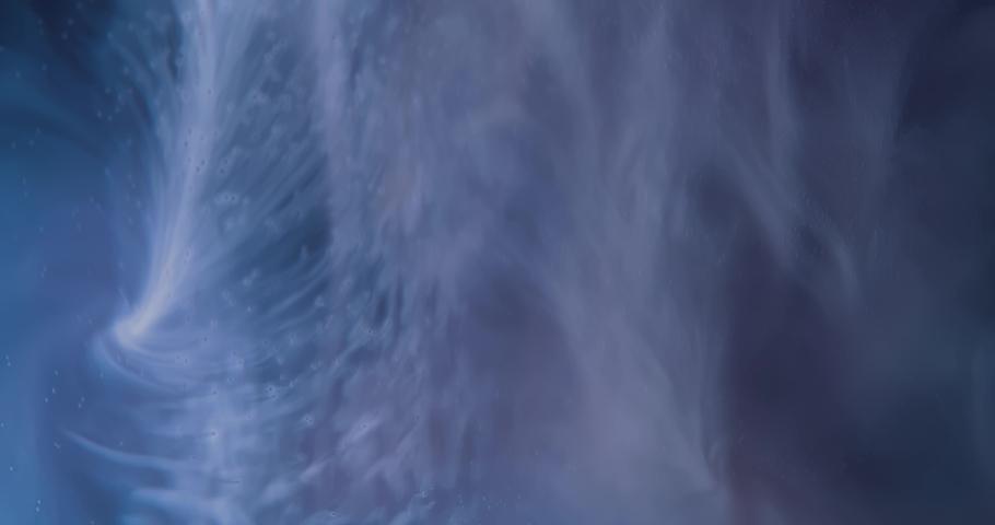 White  Fluid  in Motion underwater. Black Background. Macro.  Liquids Threads. | Shutterstock HD Video #1046871040