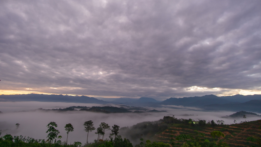 Time lapse : Majestic Mount Kinabalu view with mountains layer below, clouds in motion and foggy morning landscape. Malaysia destinations and nature.    Shutterstock HD Video #1046872900