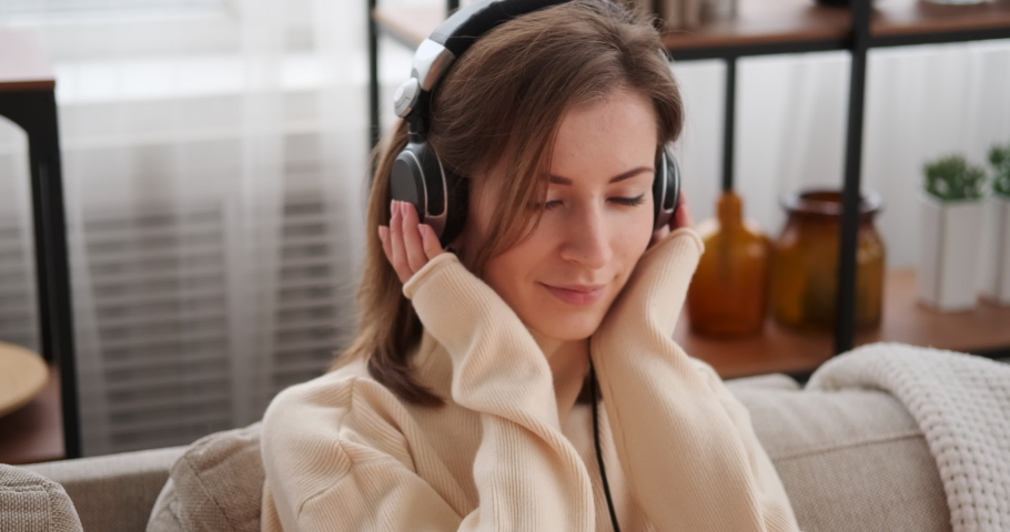 Woman listening to music on headphones | Shutterstock HD Video #1046955340