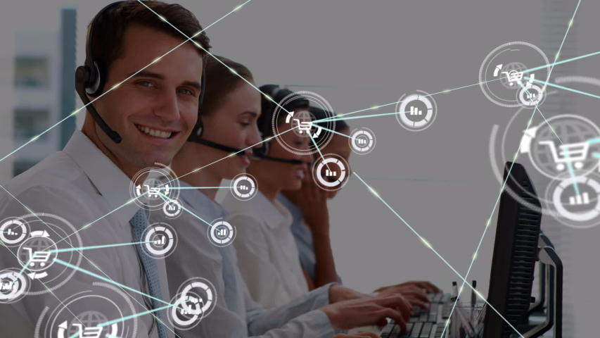 Animation of network of connections with statistics and shopping trolley icons with a group of office workers wearing phone headsets in a busy office in the background. Global networking and | Shutterstock HD Video #1046981650