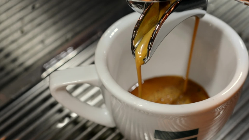 Coffee machine making espresso in single cup covered with steam in cafe bistro | Shutterstock HD Video #1047127030