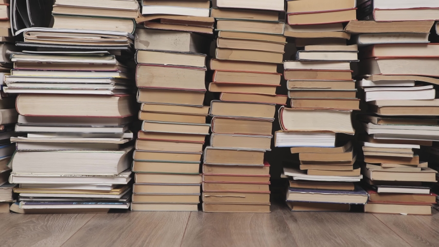 Pile of book with in the attic, camera pushing in | Shutterstock HD Video #1047177220