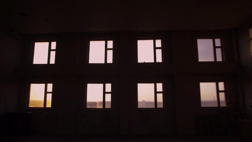 Windows. Many windows. Evening. Sunset. The room is dark. Summer.  | Shutterstock HD Video #1047261280