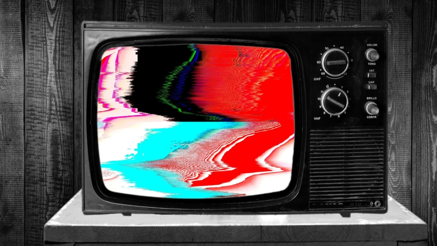 Zoom in then fixed shot on a archaic TV set, failed reception, glitch rgb cmyk | Shutterstock HD Video #1047286510