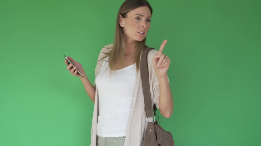 Woman walking with purse and smartphone, green screen | Shutterstock HD Video #1047332680