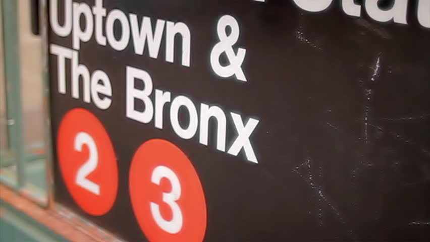 NEW YORK - FEB 9, 2010: 125 Street Station sign for Uptown and The Bronx 2 and 3 subway train line in Harlem NY. Harlem is a famous neighborhood in Manhattan, NYC, USA.