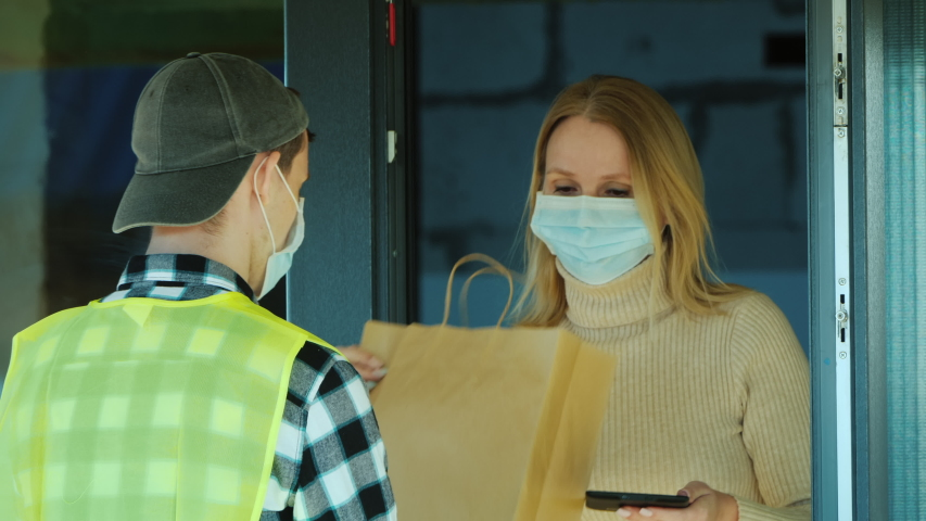 The courier delivers food home. Delivery of food in quarantine | Shutterstock HD Video #1048807000