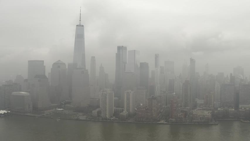 4K Aerial Footage, New York City skyline with urban skyscrapers under heavy fog. | Shutterstock HD Video #1048840960