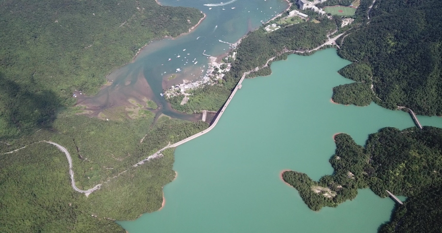 Aerial view of Tai Tam Tuk Reservoir with Dam in the Redhill Penisula of Hong Kong										  | Shutterstock HD Video #1049561080