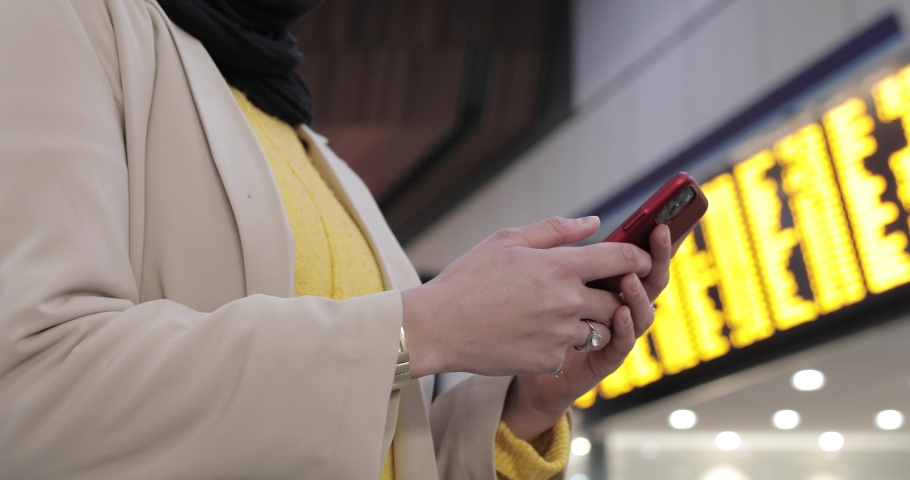 Close-up of woman hand's using smartphone at the station | Shutterstock HD Video #1049571490