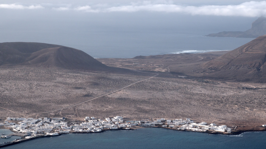 The sea and horizon at La Graciosa, an island in the Canaries. | Shutterstock HD Video #1049621590