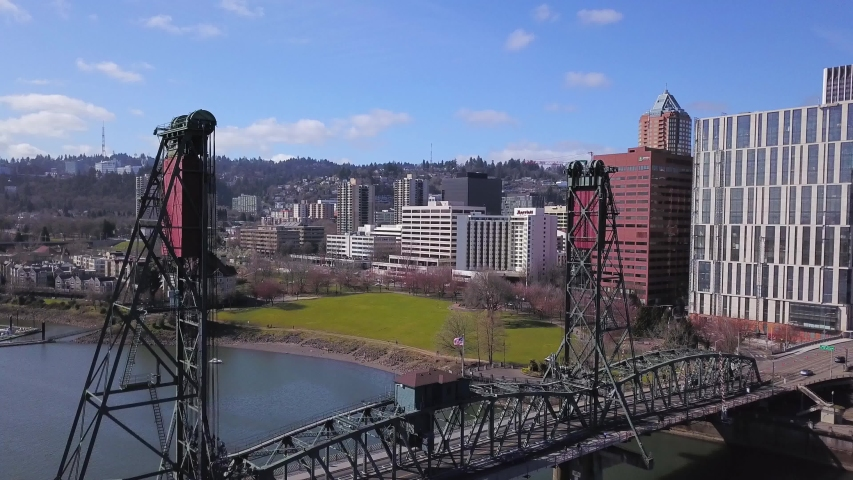 Aerial flying through Hawthorne Bridge towards highrise buildings in south downtown Portland Oregon. | Shutterstock HD Video #1049623030