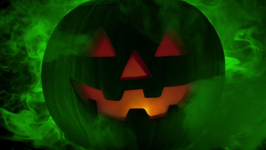 Green Smoke Rushing Out Of Halloween Pumpkin | Shutterstock HD Video #1049884720